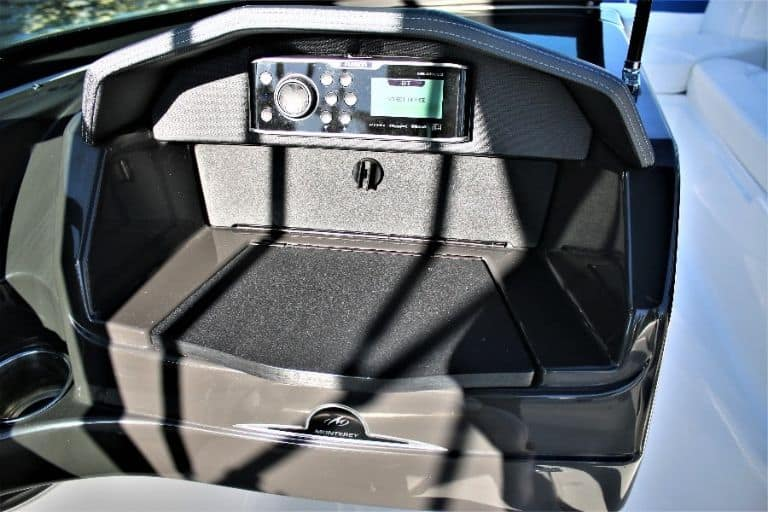 Image of Monterey 217 Bowrider stereo and storage compartment