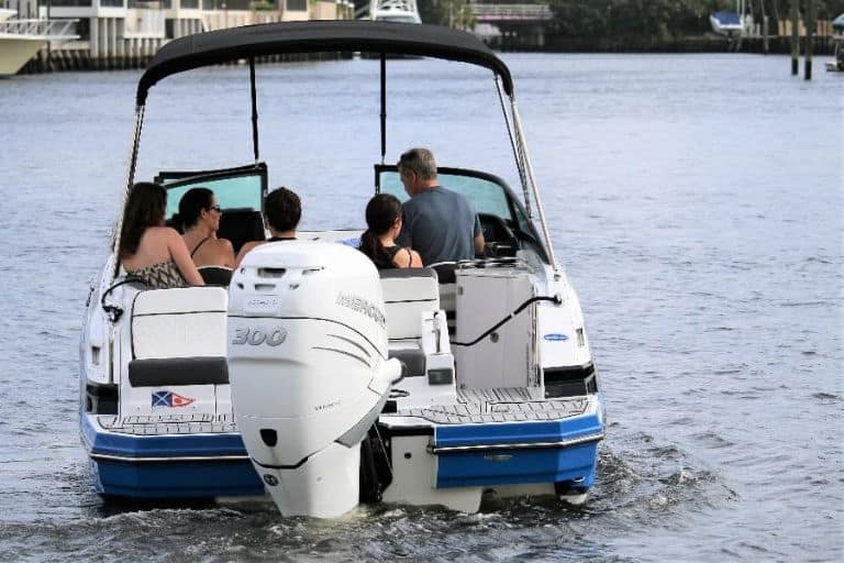 Image of family aboard rental boat with 300 HP mercury utboard