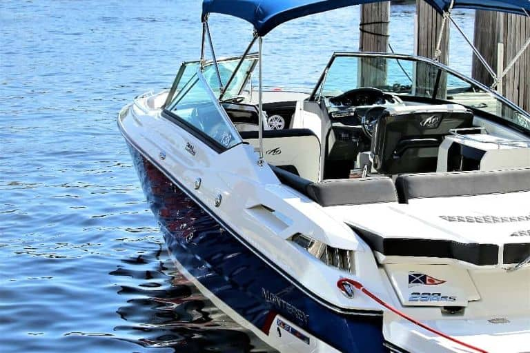 Side view of blue & white Monterey bowrider at the boat rental dock