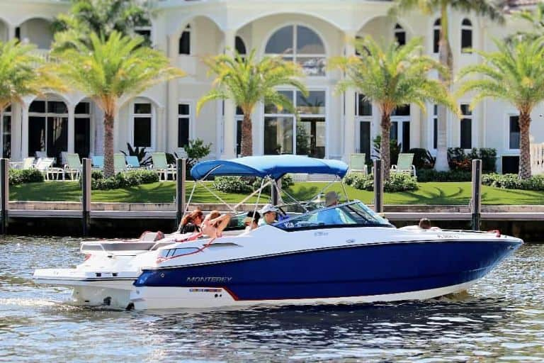 Image of sleek blue Monterey super sport bowrider with mansion in background